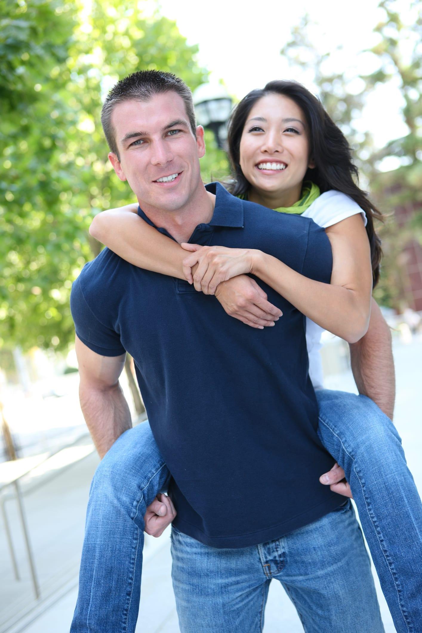 Fiance holding fiancee